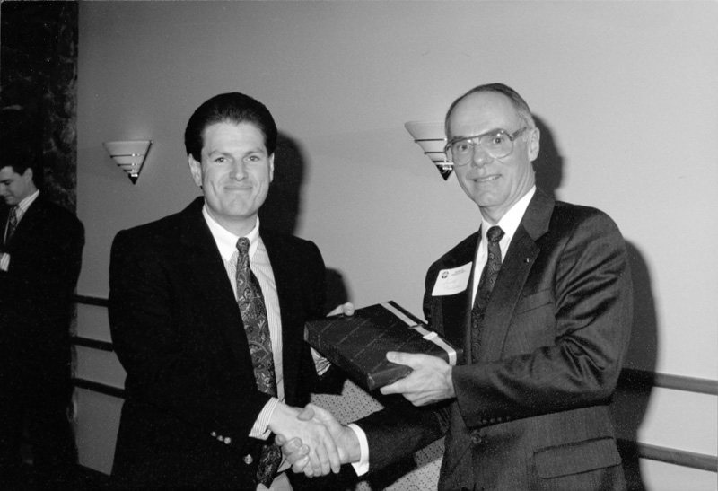 Chuck Gates receives his Leadership Utah diploma from Scott Nelson, 1992.