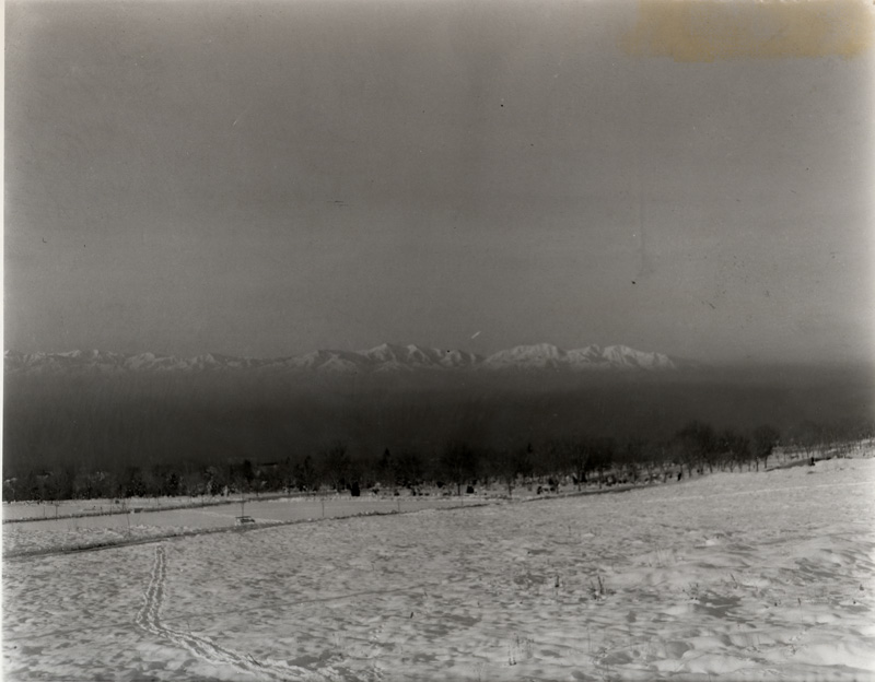 Snow-capped mountains emerge from the smog covering the Salt Lake Valley in 1942. Smoke abatement was a Chamber priority since its beginning.